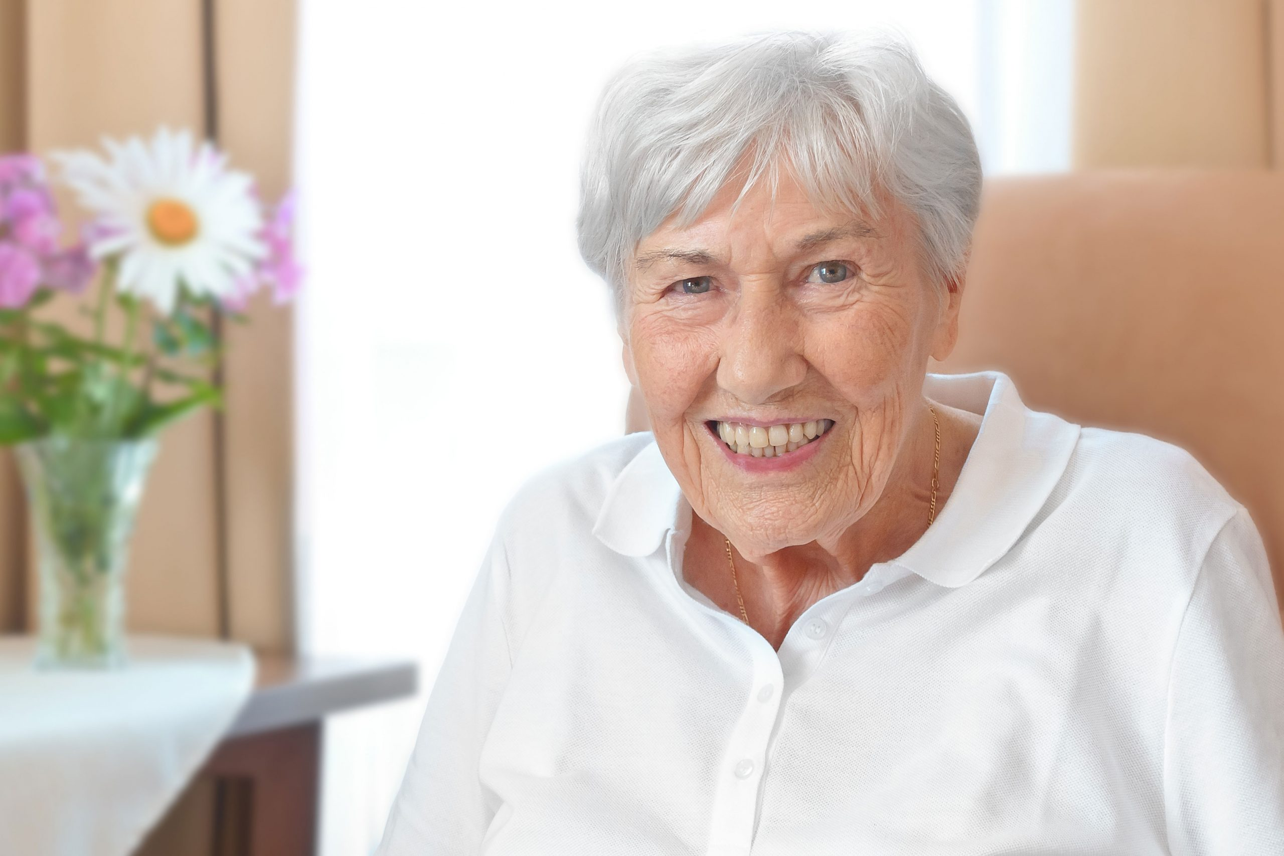 Smiling elderly woman sitting on couch